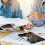 Two people working on academics